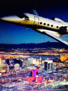 Vegas Express Jet A charter jet flying over the lLas Vegas Strip at night